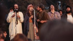 Beat poet, Allen Ginsberg addresses the Human Be-In with hippie singers backing him up. Golden Gate Park, San Francisco, California, USA. (Photo by Henry Diltz/Corbis via Getty Images)