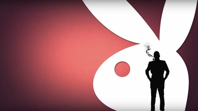 Silhouette of Hugh Hefner in front of the Playboy Rabbit