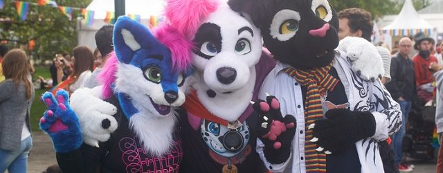 Malmö, Sweden - August 6, 2016: Three people at Malmö Pride Parade dressed as carton animals often referred as Furry fandom.