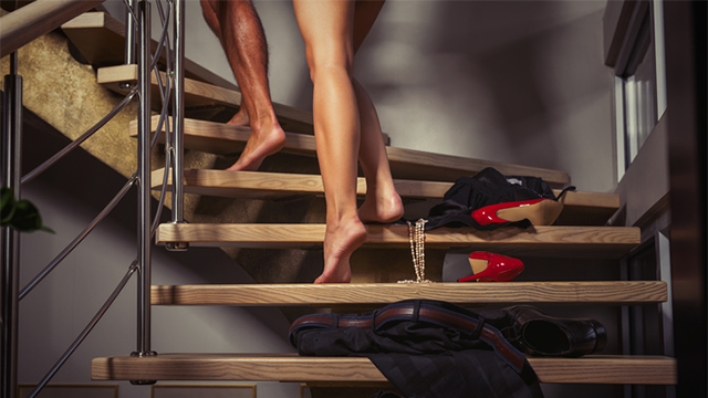 Couple going upstairs to the bedroom
