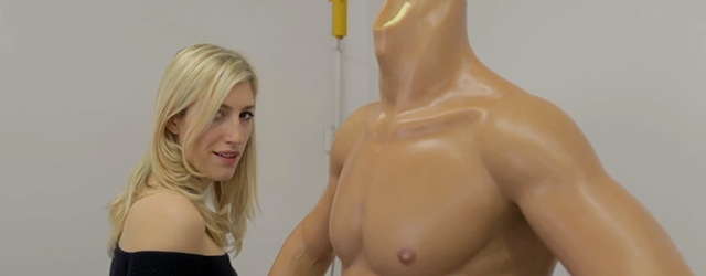 Karley Sciortino of Vice looks over a male sex doll in production