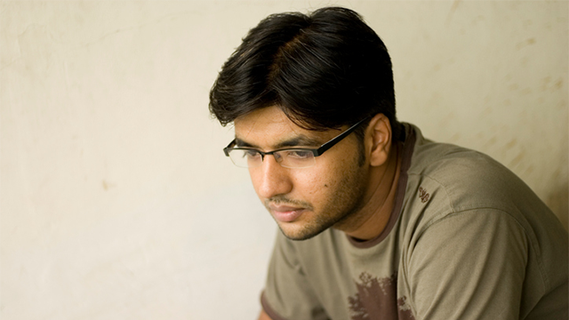 A young person sitting alone