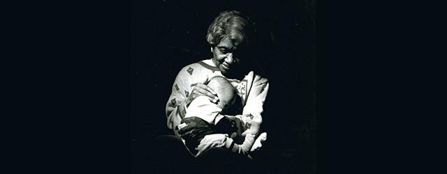 Clara Hale holding a baby